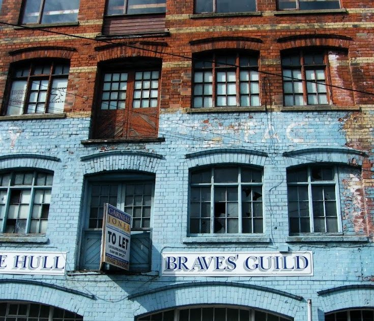 A Victorian building painted blue with the words The Hull Braves' Guild in blue writing above the windows at street level. From Hull.