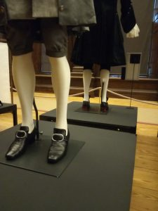 Tory red heels in The Favourite costume design