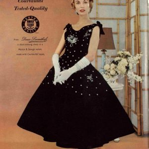 A colour advert from 1956 from the fashion label Doree Leventhal. The model is wearing a sleeveless black gown with bows on the shoulders, white elbow length gloves, and a full skirt. Across the bodice and skirt are white dots and a floral design. It says a short evening dress in a Martin and Savage velvet made with Courtaulds rayon.