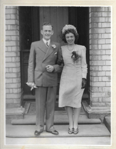 Betty Bartlett, Hull Dressmaker marries in 1942 wearing a knee length Turquoise dress she made herself, matching her red hair.