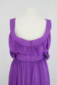 The back bodice shows the clever construction. The chiffon type fabric is synthetic but semi-transparent.