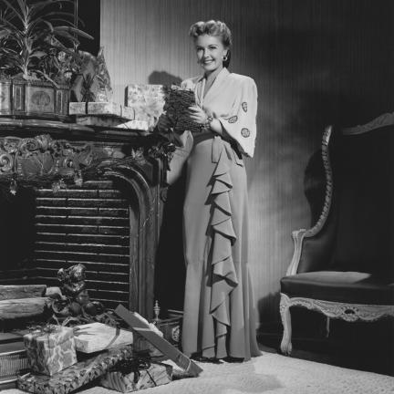 1940s Christmas Fashion Woman wearing a full length gown