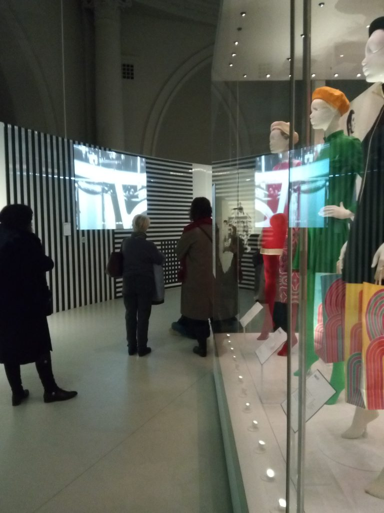 The audience watches a film at Mary Quant V&A Exhibition